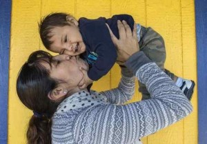 "Sandra Dimas with her son Joseph, 8 months, at the Pomona Economic Opportunity Center, a safe place for day laborers and employers to come together. Dimas is from Michoacan, Mexico and is not a U.S. citizen but her baby is. She says of a Trump presidency, ""This country is not supposed to be racist. What's wrong with wanting to come here and make a better life for your kids and yourself?"" (Photo by Mindy Schauer, Orange County Register/SCNG)"